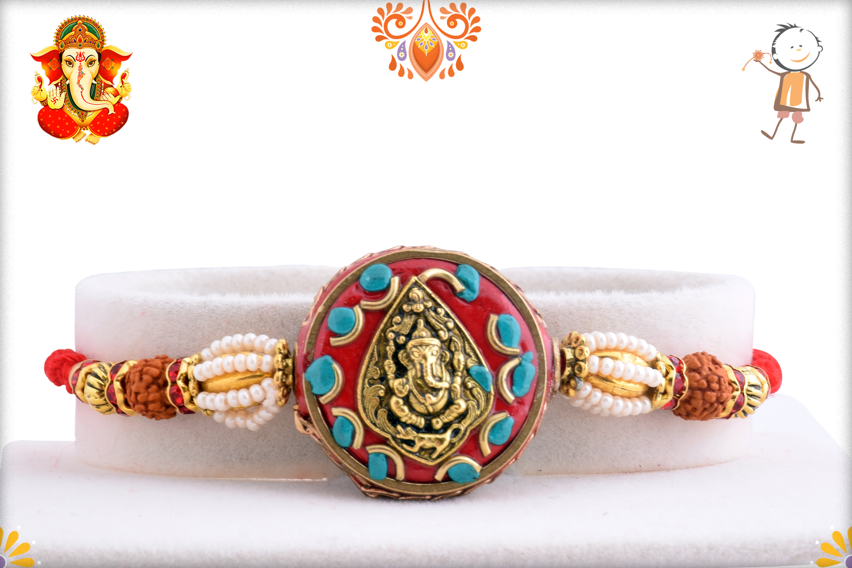 Golden Leaf Ganpati With Royal Red Base And Rudraksha Rakhi 1