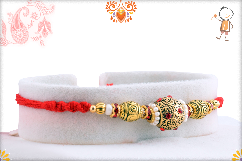 Lumious Golden And White Pearls Rakhi 2