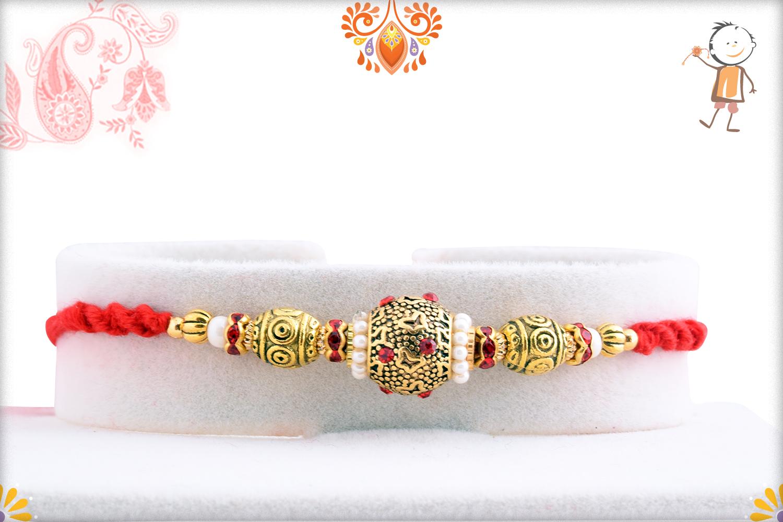 Lumious Golden And White Pearls Rakhi 1