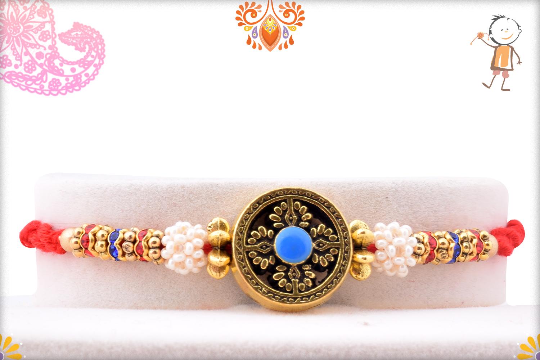 Exclusive Designer Golden Rakhi With Flower Of White Pearls 2