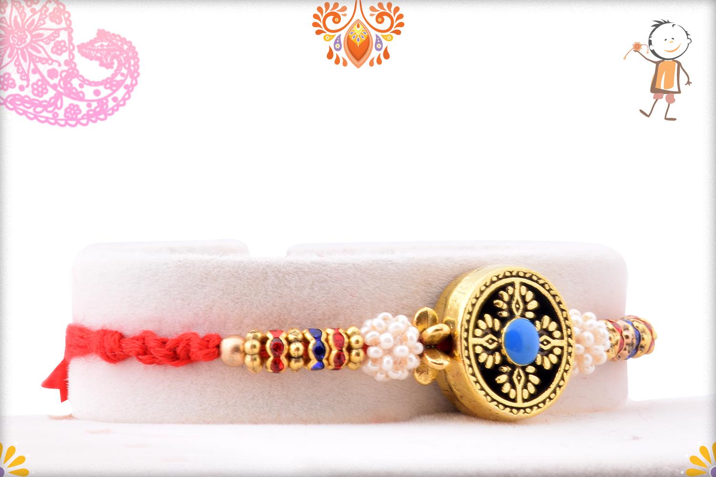 Exclusive Designer Golden Rakhi With Flower Of White Pearls 1