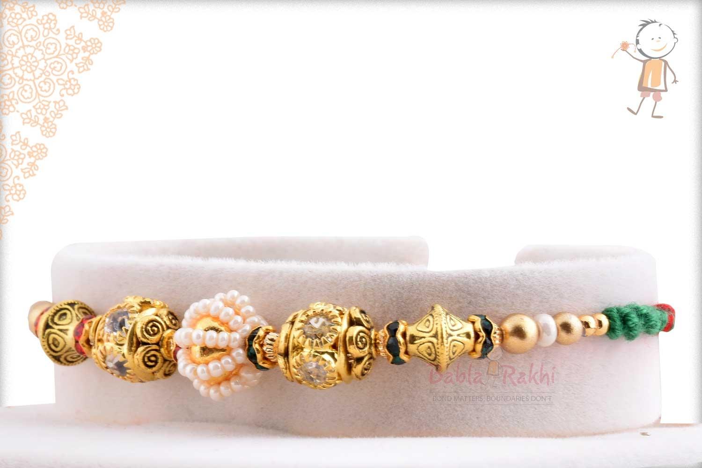 Antique Diamond Bead with Pearl Rakhi 2
