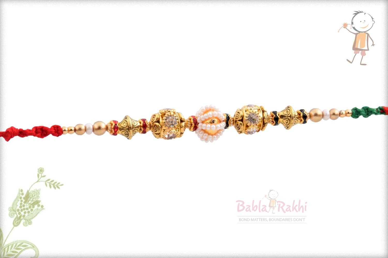 Antique Diamond Bead with Pearl Rakhi 3