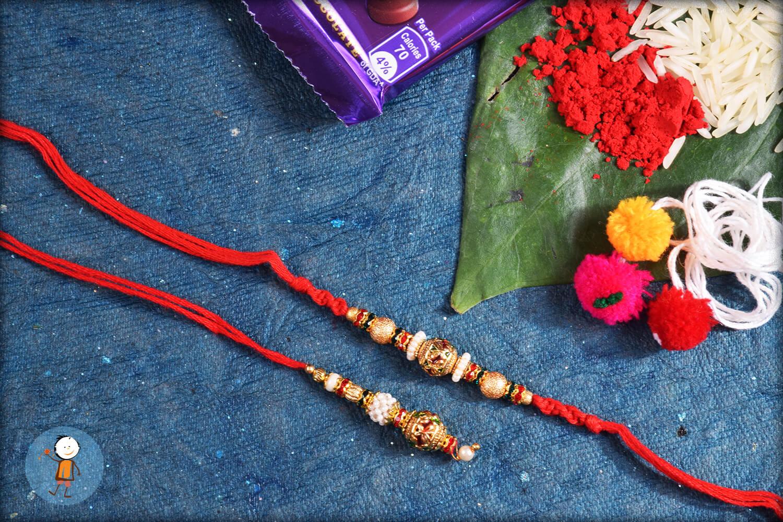 Shiny Golden Designer Pearl With Red Thread Bhaiya Bhabhi Rakhi 1