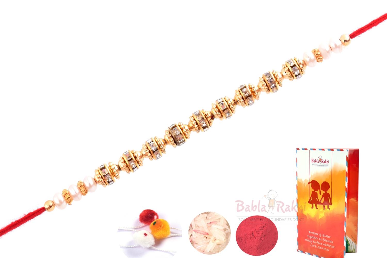 Elegant Diamond Gold Plated Rakhi 2
