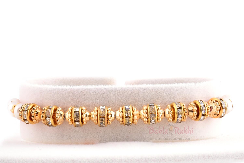 Elegant Diamond Gold Plated Rakhi 1