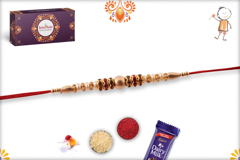 Simple Yet Elegant Combination Of Golden And White Pearl Rakhi 1