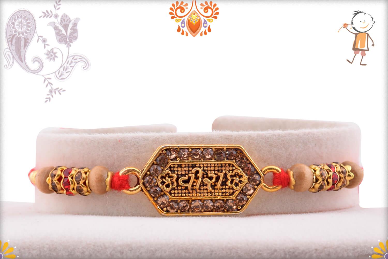 Precious Golden Metalique Hexagon Shape Vira Rakhi With Diamond 1