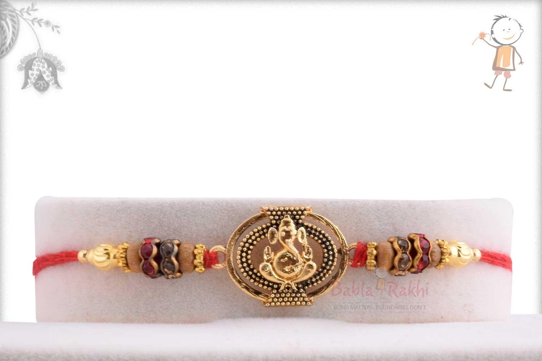 Exclusive Oval Ganpati Rakhi with Diamond Rings 1