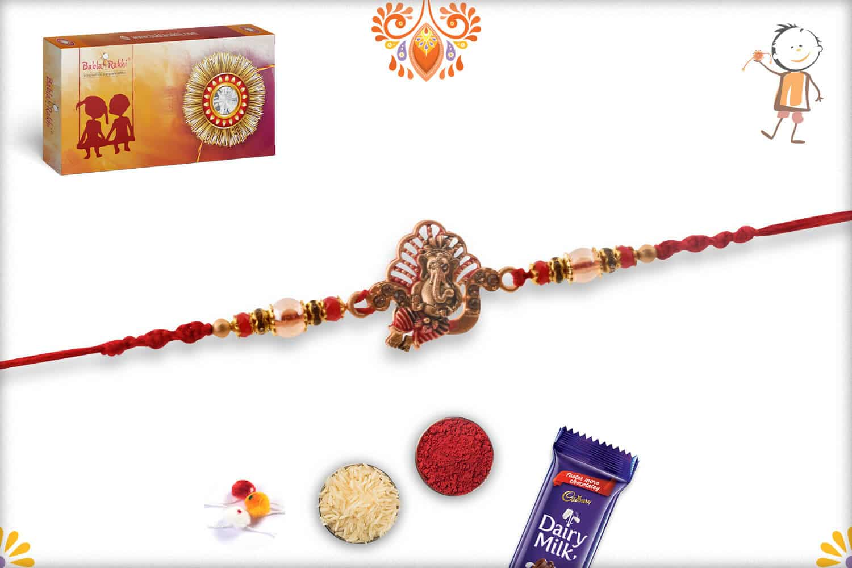 Divine Ganesh Rakhi with Diamonds and Red Beads - Babla Rakhi