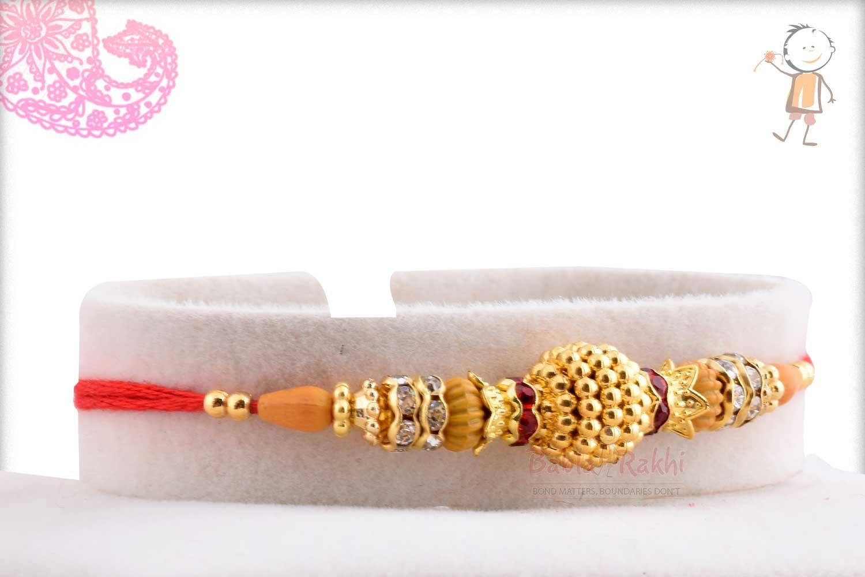 Exclusive Golden Bead Rakhi with Diamond Rings 2