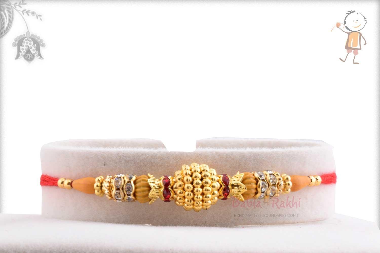 Exclusive Golden Bead Rakhi with Diamond Rings 1