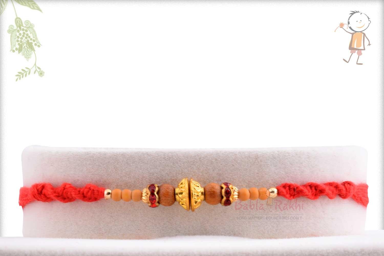 Designer Golden Beads Rakhi with Red Diamond Rings 1
