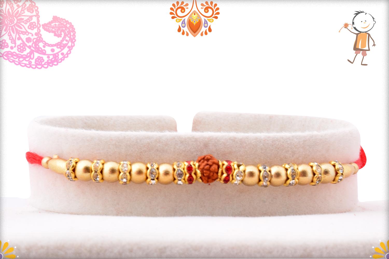 Golden Pearls Beads With Single Rudraksha Rakhi 1