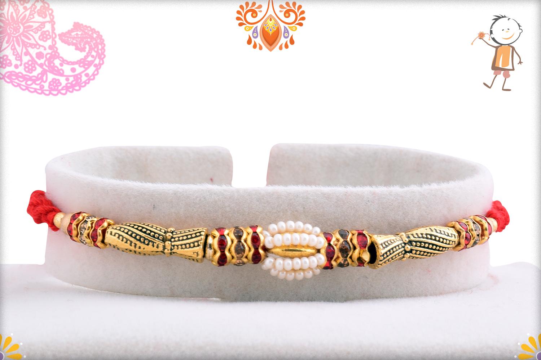 Classic Golden Design With White Owl Shape Pearl Rakhi 1