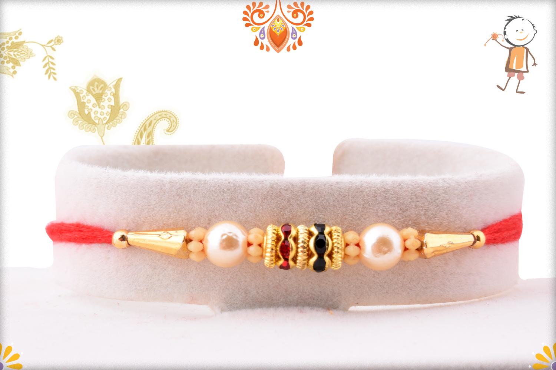 Simple Yet Eyecatching Golden & White Pearl Rakhi 1