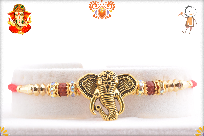 Golden Ganesha With Red Thread Rakhi 1