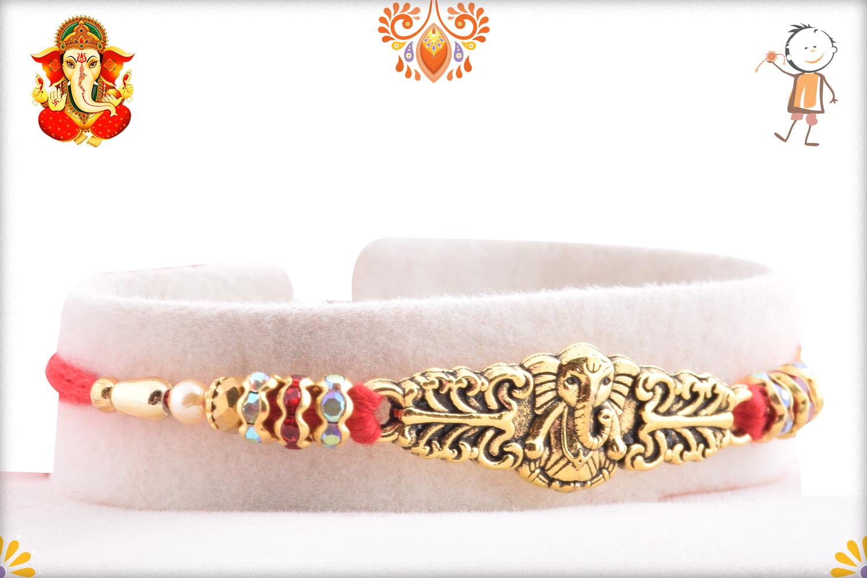 Exclusive Golden Ganesha With Red Tread Rakhi 2