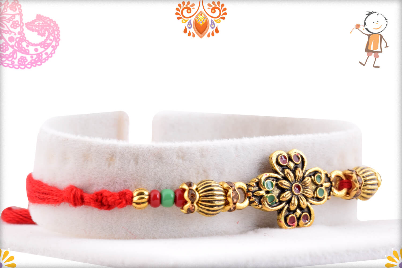 Eye Catching Golden Metalique Designer Rakhi With Red Thread 2