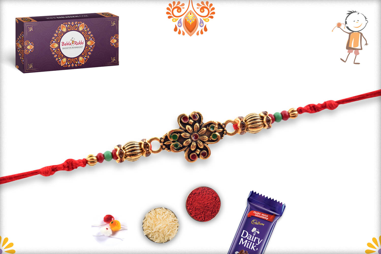 Eye Catching Golden Metalique Designer Rakhi With Red Thread 3