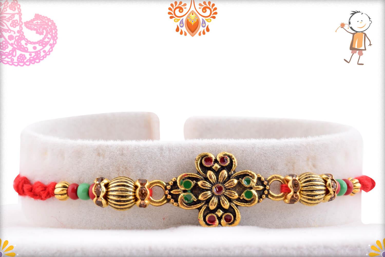 Eye Catching Golden Metalique Designer Rakhi With Red Thread 1