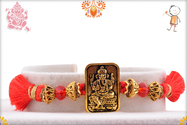 Metalique Ganesha Chabi With Designer Thread Rakhi 1