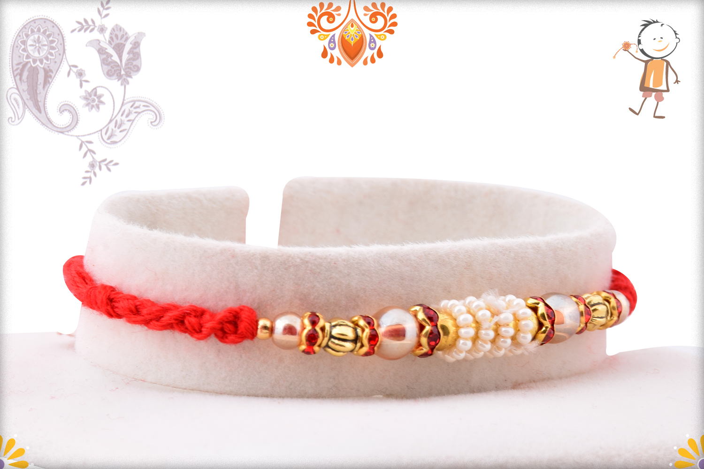 Stunning Combination of White And Golden Rakhi 2