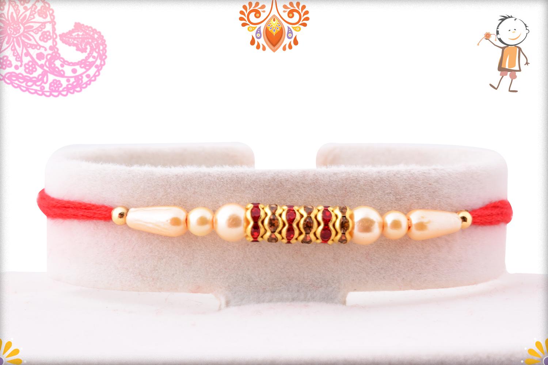Spiritual Svastik with Pearls and Red Thread Rakhi 1