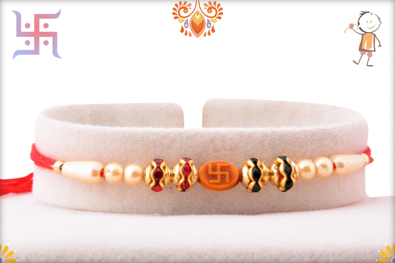 Spiritual Svastik Om Pearls and Red Thread Rakhi 1