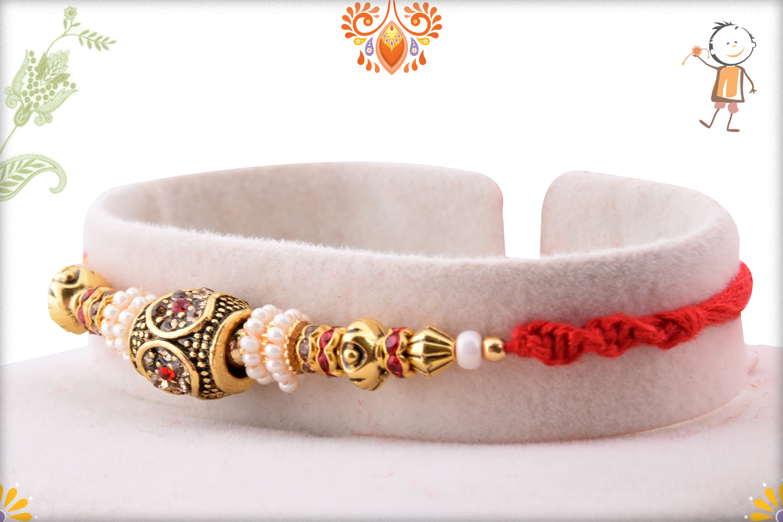 Premium Designer Golden Rakhi with Red Thread 2