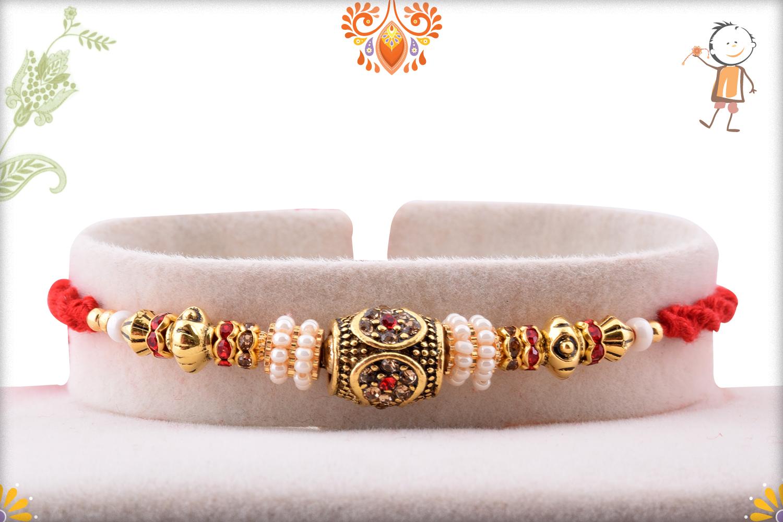 Premium Designer Golden Rakhi with Red Thread 1
