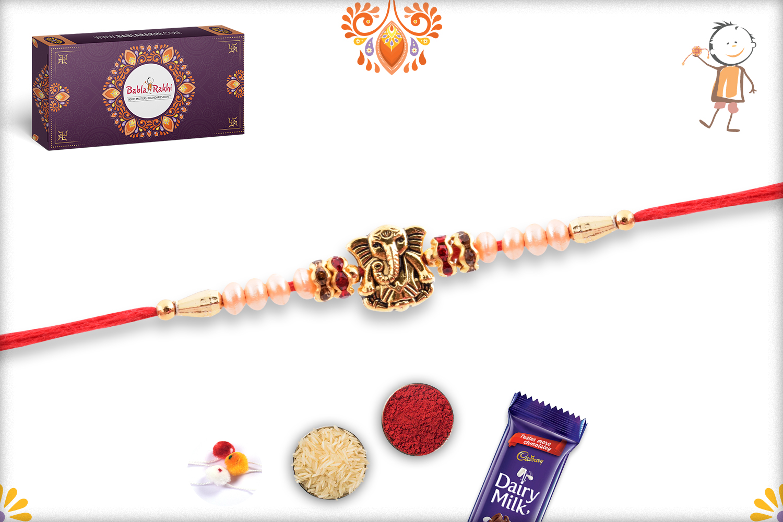 Exclusive Golden Ganesha and White Pearl Rakhi 2
