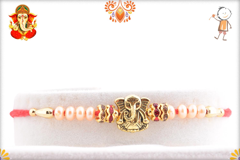 Exclusive Golden Ganesha and White Pearl Rakhi 1