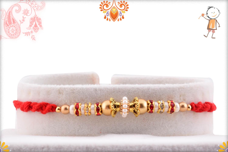 Evergreen Golden Beads And Red Designer Thread Rakhi 1