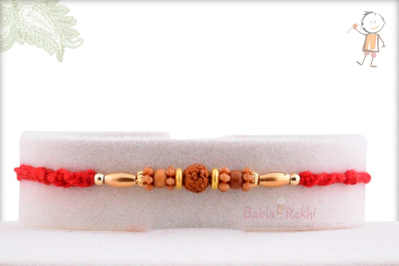Simple Rudhraksh Rakhi with Oval Golden Beads 1