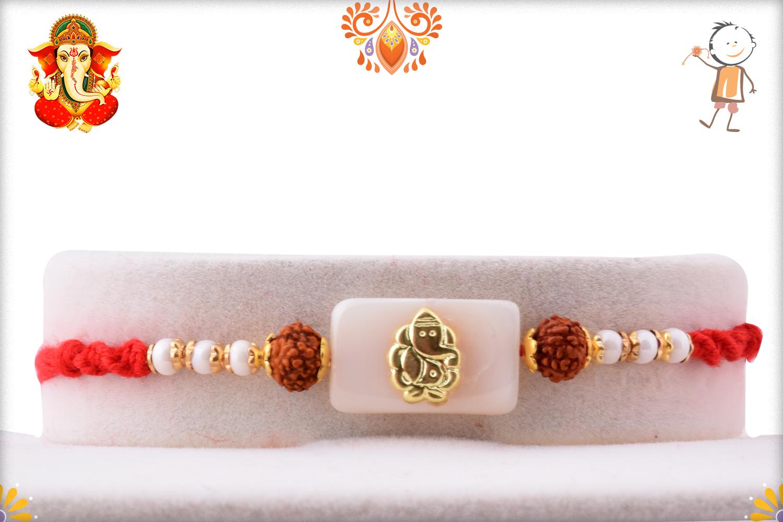 Prosporous Combination Of White Marble And Golden Ganpati With Rudraksha Rakhi 1