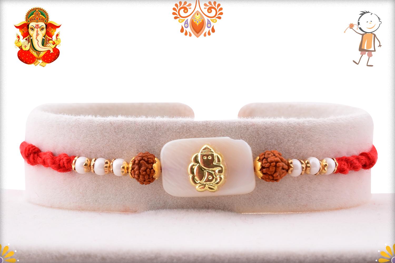 Stunning Golden Ganpati With Marble and Dual Rudraksha Rakhi 1
