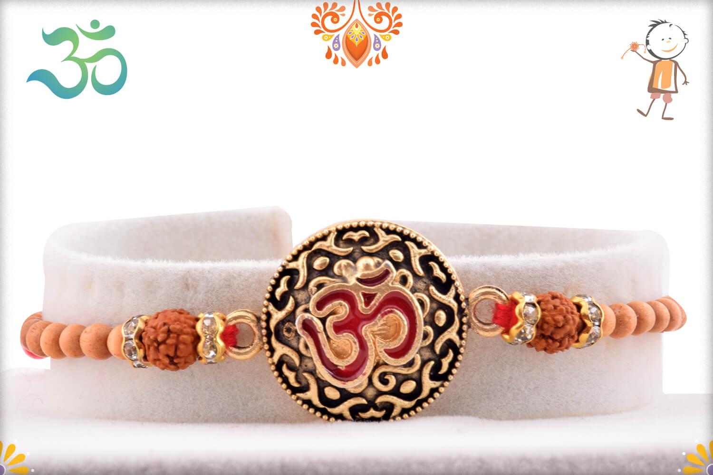 Royal Metal Base Om With Rudraksha And White Beads Rakhi 1