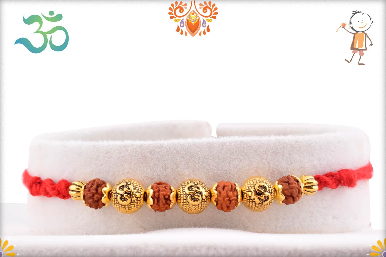 Aspisious Golden Designer Beads With Om In Center And Rudraksha Rakhi 1