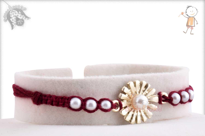 Beautiful Silver Flower with Pearls Rakhi 2