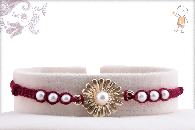 Beautiful Silver Flower with Pearls Rakhi 1