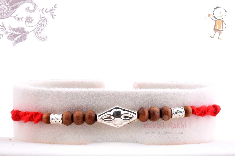 Beautiful Silver Rakhi with Sandalwood Beads 1