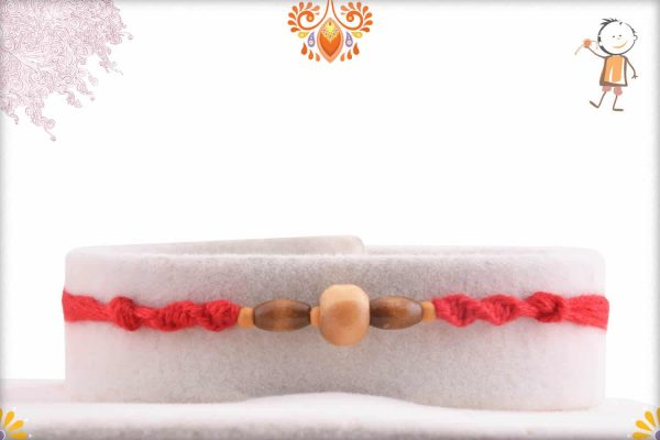 Simple Sandalwood Rakhi with Handcrafted Red Thread - Babla Rakhi