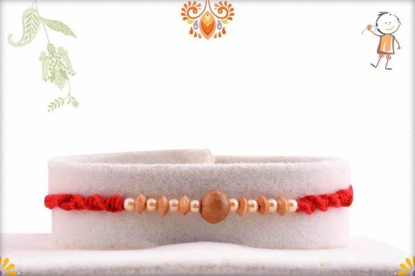 Designer Sandalwood Rakhi with Attractive Pearls - Babla Rakhi