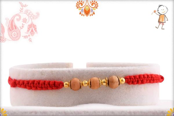 Uniquely Knotted 3 Sandalwood Beads Rakhi with Golden Beads - Babla Rakhi