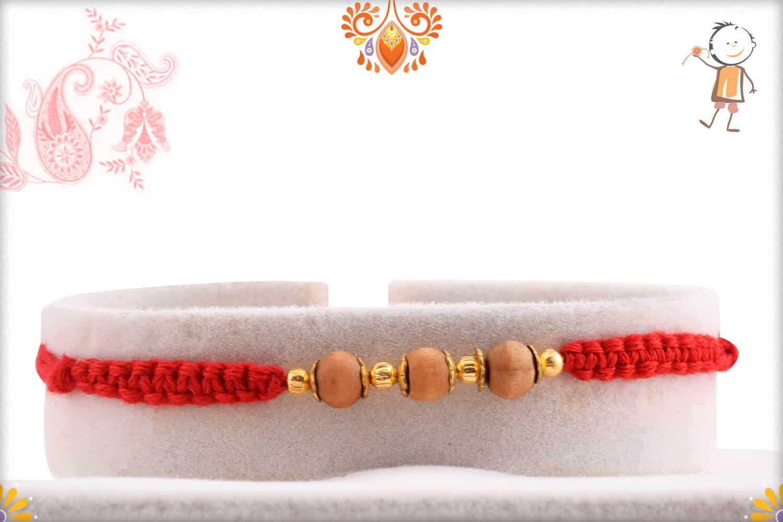 Uniquely Knotted 3 Sandalwood Beads Rakhi with Golden Beads - Babla Rakhi