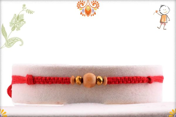 Uniquely Knotted Sandalwood Rakhi with Bicone Golden Beads - Babla Rakhi