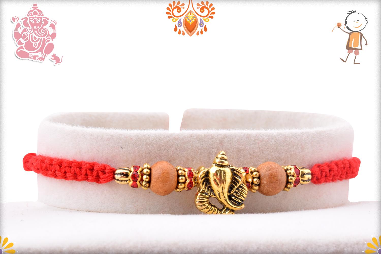 Exclusive Golden Ganpati Rakhi With Wooden Beads and Designer Thread 1