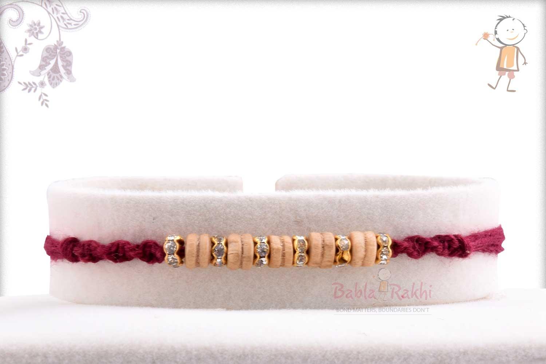 Beautiful Sandalwood Beads Rakhi with Diamond Rings 1