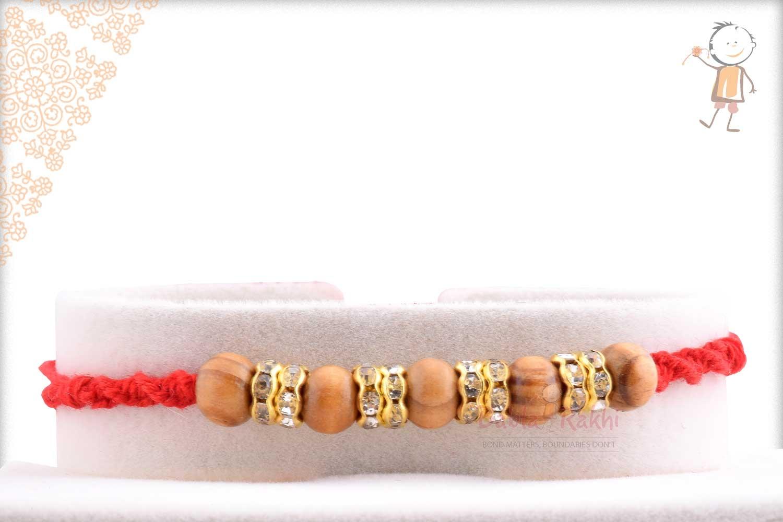 Five Sandalwood Beads Rakhi with Diamond Rings 1